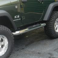 """SIDE STEP 4 INCH ROUND 2-DOOR STAINLESS STEEL JK 07-09Tube steps for the new 2007-08 Wrangler are custom designed for the oversized features of this hot new vehicle. Unlike smaller tube designs, these large round tubes provide a much cleaner look and are not """"dwarfed"""" by oversized tires and body large round tubes provide a much cleaner look and are not """"dwarfed"""" by oversized tires and body style. Rugged Ridge Stainless Tube Steps feature prime 304L, .05"""" wall stainless tubing polished to a mirror finish. The polishing process for a Rugged Ridge step is longer and deeper pulling out the deepest shine from the steel. A true -deep polish-! All Rugged Ridge Tube steps feature no-drill installation for ease of installation and a truly custom fit. All Tube Step Installation  brackets are constructed of durable 3/16"""" powdercoated steel for long life and years of flex-free use. Each Tube Step features special UV treated no-slip step pads with 5 mounting pins. These step pads are installed on top of the tube - no exposed metal to rust.          Replaces: 11593.09Made in CHINAUPC: 804314159191Label: SIDE STEP 4-IN RND 2DR JK SS"""